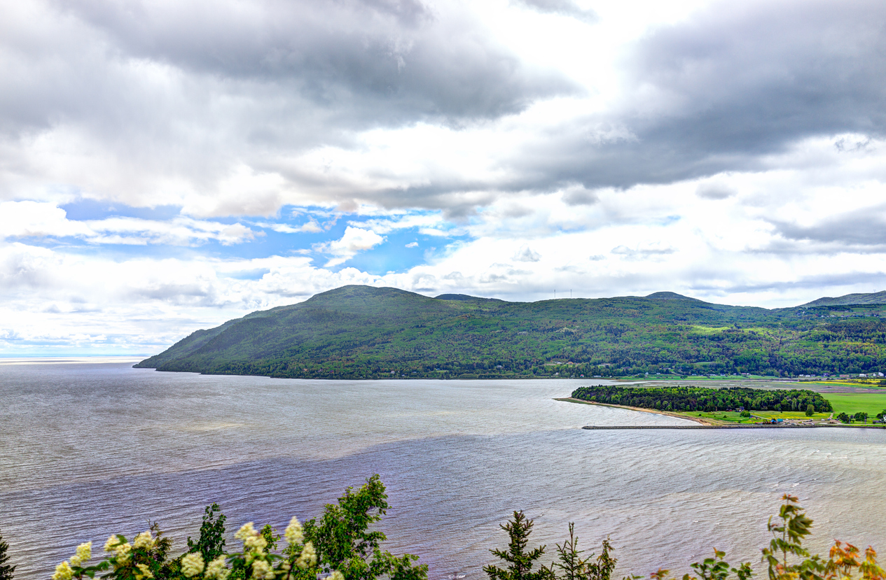 Baie-Saint-Paul in Quebec, Canada cityscape or skyline with mountains on coast and Saint Lawrence river
